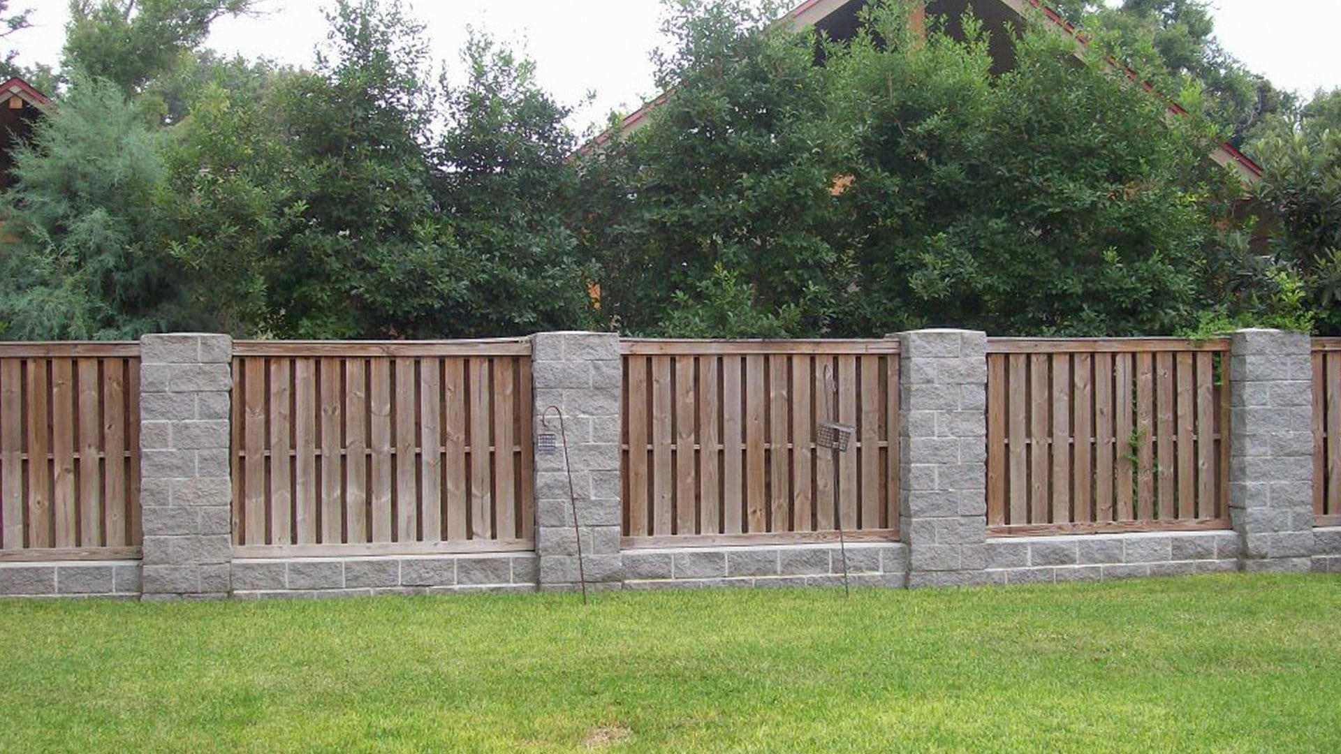 Wooden fencing and cobblestone